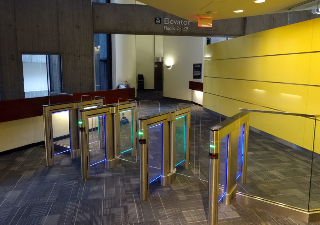 Sleek and modern turstiles grace an entrance lobby.